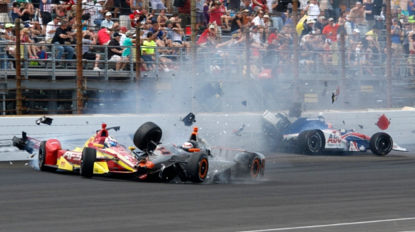 Stefano Coletti, of Monaco, (4) hits the car driven by Sebastian Saavedra, of Colombia, as Jack Hawksworth, right, of England, hits the wall in the closing laps of the 99th running of the Indianapolis 500 auto race at Indianapolis Motor Speedway in Indianapolis, Sunday, May 24, 2015.  (AP Photo/Kirk Stierwalt) ORG XMIT: NAA147