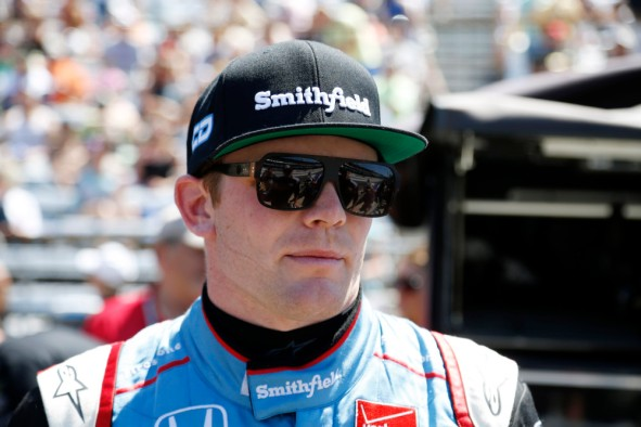 May 22, 2015; Indianapolis, IN, USA; Verizon IndyCar Series driver Conor Daly stands in the pits during Carb Day for the 2015 Indianapolis 500 at Indianapolis Motor Speedway. Mandatory Credit: Brian Spurlock-USA TODAY Sports ORG XMIT: USATSI-225330 ORIG FILE ID: 20150520_pjc_ss1_382.JPG
