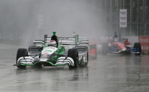 Carlos Munoz of Colombia competes during the first race of the IndyCar Detroit Grand Prix auto racing doubleheader Saturday, May 30, 2015, in Detroit. Munoz has his first career IndyCar victory when the race was called because of rain after 47 laps. (AP Photo/Carlos Osorio)