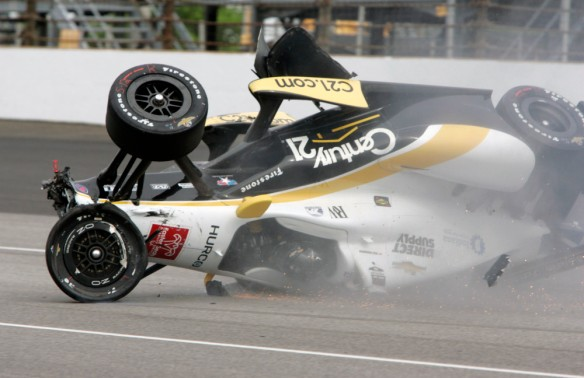 The car driven by Josef Newgarden slides down the track after hitting the wall in the first turn and going airborne during practice for the Indianapolis 500 auto race at Indianapolis Motor Speedway in Indianapolis, Thursday, May 14, 2015. (AP Photo/Joe Watts) ORG XMIT: NAA120