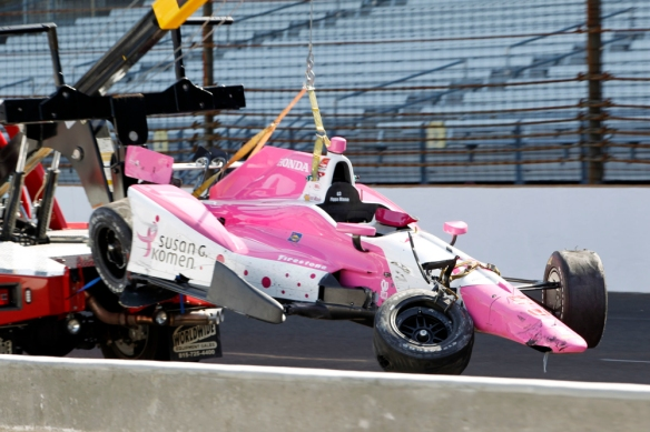 The car of Pippa Mann, of England, is hauled back to the garage area after a crash during practice for the Indianapolis 500 auto race at Indianapolis Motor Speedway in Indianapolis, Wednesday, May 13, 2015. (AP Photo/AJ Mast) ORG XMIT: NAA120
