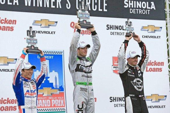 May 31, 2015; Detroit, MI, USA; IndyCar Series driver Takuma Sato (left) Sebastien Bourdais and Graham Rahal celebrate in victory circle after the Dual in Detroit Race 2 at Belle Isle road course. Mandatory Credit: Andrew Weber-USA TODAY Sports ORG XMIT: USATSI-225300 ORIG FILE ID:  20150531_lbm_aw3_258.JPG