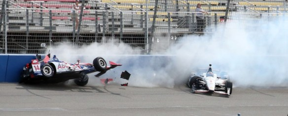 FONTANA, CA - JUNE 27: Race car drivers Takuma Sato, (L) and Will Power crash during the Indy Car MAVTV 500 race at the Auto Club Speedway on June 27, 2015 in Fontana, California.  (Photo by Frederick M. Brown/Getty Images) ORG XMIT: 559245295 ORIG FILE ID: 478814752