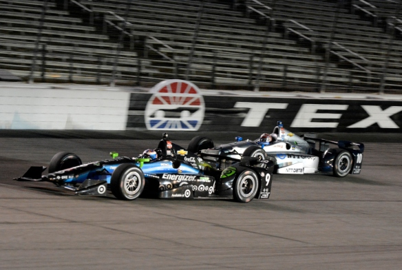 Scott Dixon (9), of New Zealand, leads Tony Kanaan (10), of Brazil, out of Turn 4 late in the Firestone 600 IndyCar auto race at Texas Motor Speedway in Fort Worth, Texas, Saturday June 6, 2015. Dixon won the race and Kanaan finished in second. (AP Photo/Larry Papke) ORG XMIT: TXTG135