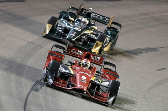 Sage Karam (8) leads Ed Carpenter during the IndyCar Series auto race Saturday, July 18, 2015, at Iowa Speedway in Newton, Iowa. (AP Photo/Charlie Neibergall) ORG XMIT: IACN120