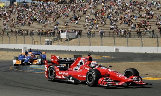 Graham Rahal, right, and Charlie Kimball (83) compete during the IndyCar Grand Prix of Sonoma auto race Sunday, Aug. 30, 2015, in Sonoma, Calif. (AP Photo/Eric Risberg) ORG XMIT: CAER108