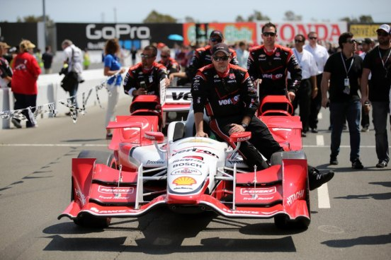 Aug 30, 2015; Sonoma, CA, USA; Pit crew for IndyCar Series driver Juan Pablo Montoya bring the car to the grid before the GoPro Grand Prix of Sonoma at Sonoma Raceway. Mandatory Credit: Kelley L Cox-USA TODAY Sports
