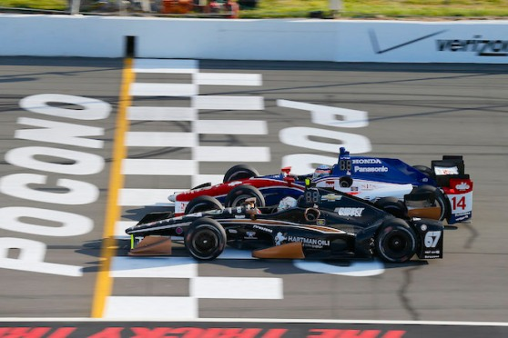 22-23 August, 2015, Pocono, Pennsylvania, USA Josef Newgarden passes Takuma Sato on the last restart © 2015, Michael L. Levitt LAT Photo USA