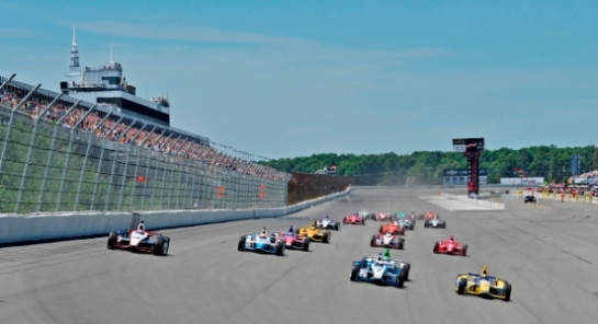 LONG POND, PA - JULY 6, 2014: The Verizon IndyCar Series Pocono INDYCAR 500 fueled by Sunoco race is held at Pocono Raceway in Long Pond, PA on July 6, 2014 (2014 pixelcrisp)