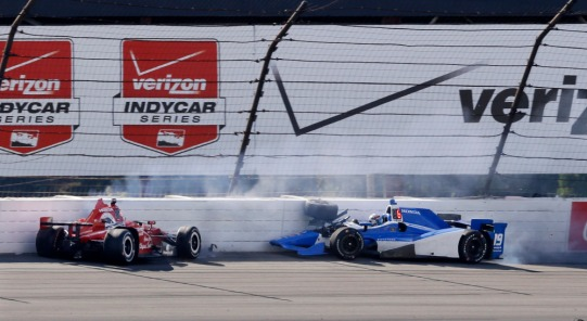 Graham Rahal, left, and Tristan Vautier, of France, hit the wall in Turn 3 after colliding during the Pocono IndyCar 500 auto race Sunday, Aug. 23, 2015, in Long Pond, Pa. (AP Photo/Mel Evans) ORG XMIT: PAME111