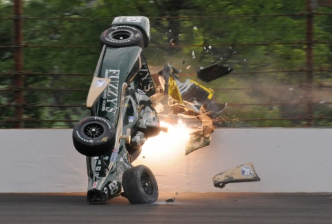 Ed Carpenter hits the wall in the second turn during practice before qualifications for the Indianapolis 500 auto race at Indianapolis Motor Speedway in Indianapolis, Sunday, May 17, 2015. Carpenter walked away from the crash and has been released from he track hospital after being checked. (AP Photo/Greg Huey) ORG XMIT: NAA103