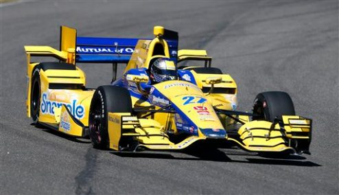 Marco Andretti (27) heads into a turn during IndyCar testing at Barber Motorsports Park, Monday, March 16, 2015, in Birmingham, Ala. Drivers are testing the new aerodynamic packages on their cars. (AP Photo/Butch Dill)